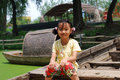 Asian little girl sitting on a wood boat Royalty Free Stock Images