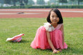 Asian little girl  In summer garden Stock Photo