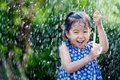 Asian little girl with umbrella in rain Royalty Free Stock Photo