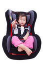Asian lovely girl at car seat and fasten seat belt image of little thai fastened with security in safety isolated on white Royalty Free Stock Images