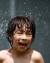 An asian loves playing with water Royalty Free Stock Images