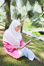 Asian Malay Muslim woman reading Stock Images