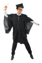 Asian male university student in graduation gown jumping full body excited isolated on white background Stock Photos