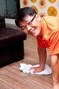 Asian man cleaning floor