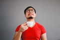 Asian man and coffee cup. Royalty Free Stock Photo