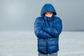 Asian man in down padded coat blue Royalty Free Stock Images