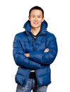 Asian man in down padded coat blue Royalty Free Stock Photo