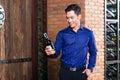 Asian man holding bottle of wine Royalty Free Stock Photo
