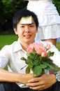 Asian Man holding Pink Roses Royalty Free Stock Images