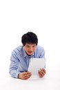 Asian man holding tablet computer Royalty Free Stock Photos