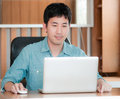 Asian man with laptop working Stock Images