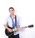 Asian man playing electric guitar on white background Royalty Free Stock Images