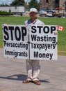Asian man protesting with signs on parliament hill ottawa canada august a august in ottawa ontario Royalty Free Stock Photography