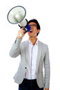 Asian man shouting with megaphone portrait of young Stock Images