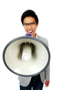 Asian man shouting with megaphone portrait of young Royalty Free Stock Photography