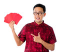 Asian man showing many red packet Stock Photo