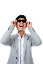 Asian man in sunglasses looking up fashion over white background Royalty Free Stock Images