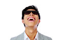 Asian man in sunglasses looking up laughing over white background Stock Photo