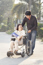 Asian man taking his elderly mother for a walk Royalty Free Stock Photo