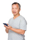 Asian man use of cellphone Royalty Free Stock Photo