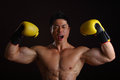 Asian Man with yellow boxing gloves posing Royalty Free Stock Images