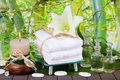 Asian massage oil with candle, towels and lily Royalty Free Stock Photo