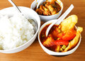 Asian meal fish vegetable curry a photograph showing a typical asia local of white rice served with curries made of vegetables and Royalty Free Stock Photo