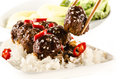Asian meatballs with chinese sauce served with rice