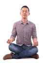 Asian meditation man calm in lotus position full body sitting isolated over white background male model Stock Photo