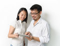 Asian men women viewing tablet pc Stock Photo