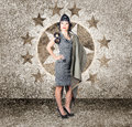 Asian military pinup girl in retro air force style old s photo of an standing a full body pose wearing army issued flight cap and Stock Images