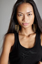 Asian model mixed female with black long hair portrait in studio lighting opposit background Royalty Free Stock Images