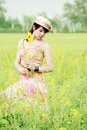 Asian model in rape field Royalty Free Stock Photos