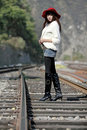 Asian model on train tracks Royalty Free Stock Photo