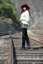 Asian Model On Train Tracks