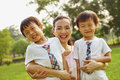 Asian mom wwith twins boys family and two in the park Royalty Free Stock Image