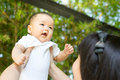 Asian mother and baby in the park Royalty Free Stock Photo