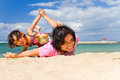 Asian mother and child fun play at the beach Stock Image
