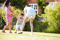 Asian mother playing in summer garden with children having fun Royalty Free Stock Image