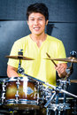 Asian musician drummer in recording studio professional playing drums Stock Photography