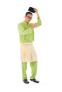 Asian muslim male with traditional malay costume in smiling acti action baju melayu Royalty Free Stock Photography