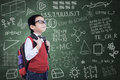 Asian nerd boy with backpack in class posing Royalty Free Stock Photos