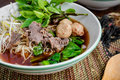 Asian noodle soup with beef meatball with fresh vegetable on woo Royalty Free Stock Photo