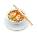 Asian noodle soup with fungus and shrimp in front of white background Stock Image
