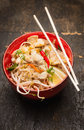 Asian noodles with chopstick chicken and sprouts in red bowl top view Royalty Free Stock Photography