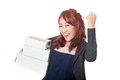 Asian office girl very happy with 3 boxes and fist pump Royalty Free Stock Photo