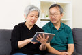 Asian old couple using tablet at home Royalty Free Stock Images