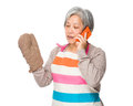 Asian old housewife talk to cellphone with oven glove Royalty Free Stock Photo