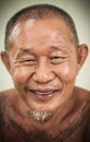 An asian old man happy face smiling and his body full of tattoo Stock Image
