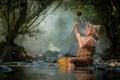 Asian old woman take a bath Royalty Free Stock Photo